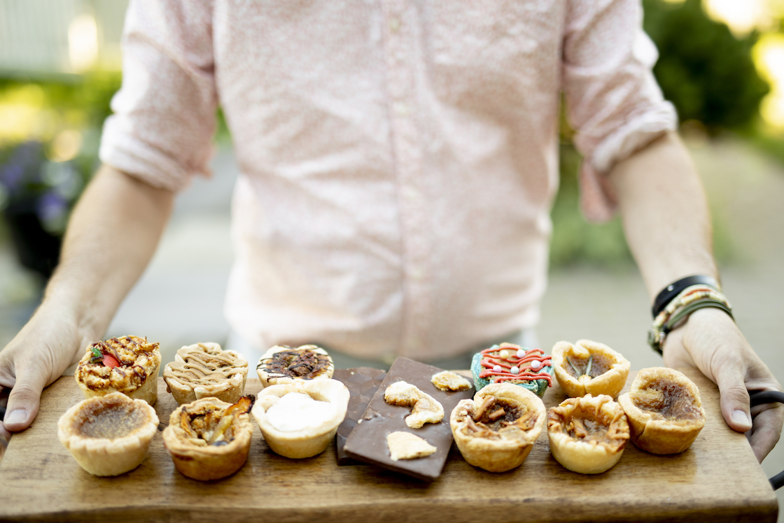 Butter tarts artfully arranged on a cutting board